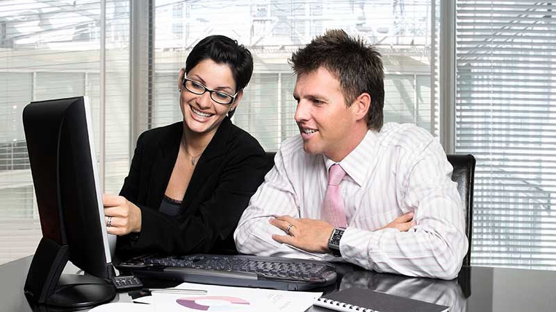 Happy Customers looking at PC screen