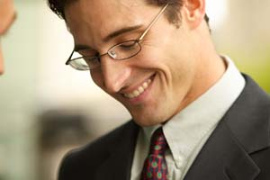 Man with glasses looking rather pleased